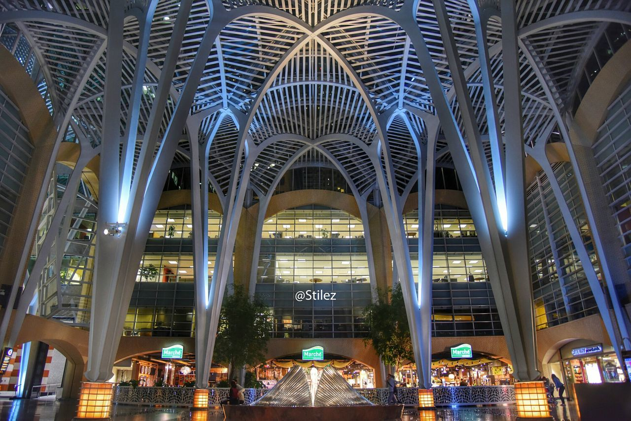 architecture, illuminated, night, built structure, modern, arch, indoors, transportation, travel destinations, building exterior, real people, city