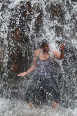 Best human photo I ever click, my friend dancing in waterfall Flying High