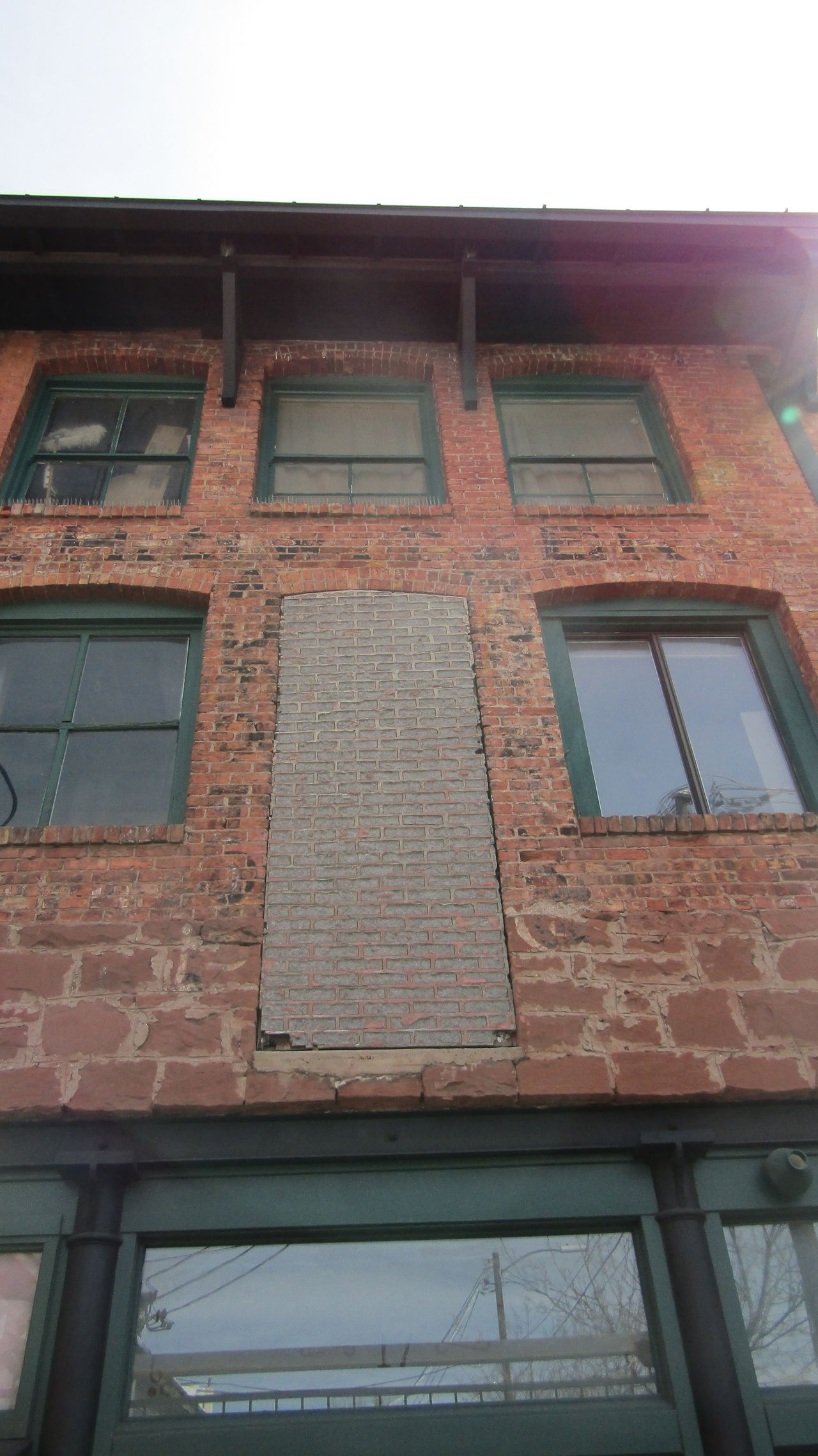Architecture Balcony Brick Wall Building Building Exterior Built Structure Clear Sky Day Exterior Glass - Material House Low Angle View No People Outdoors Residential Building Residential Structure Sky Sunlight Wall - Building Feature Window