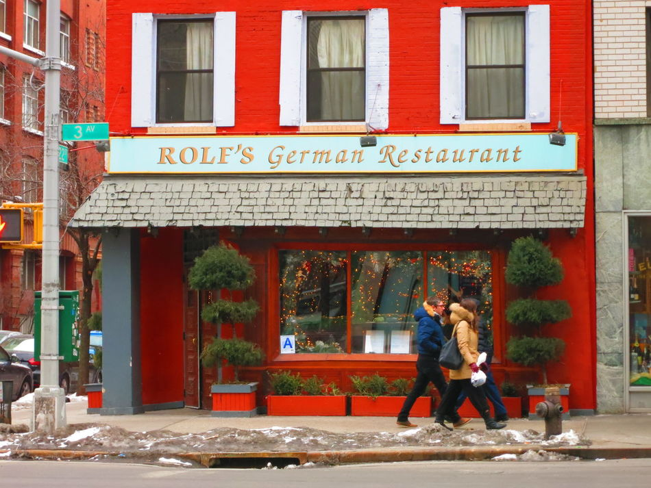 NEW YORK CITY - 2 FEBRUARY 2015: A group of friends in winter coats walk passed Rolf's German Restaurant on 3rd Avenue in Manhattan on a cold winter day. Rolf's in know for its Schwarzwald Christmas. Adults Only Architecture Bar Building Exterior City City Life Day Exterior Exterior Building Faa Famous Place Food And Drink German Restaurant Lifestyle New York City NYC Street Outdoors People Pub Restaurants Rolf Rolf's German Restaurant Walking Walking Around The City