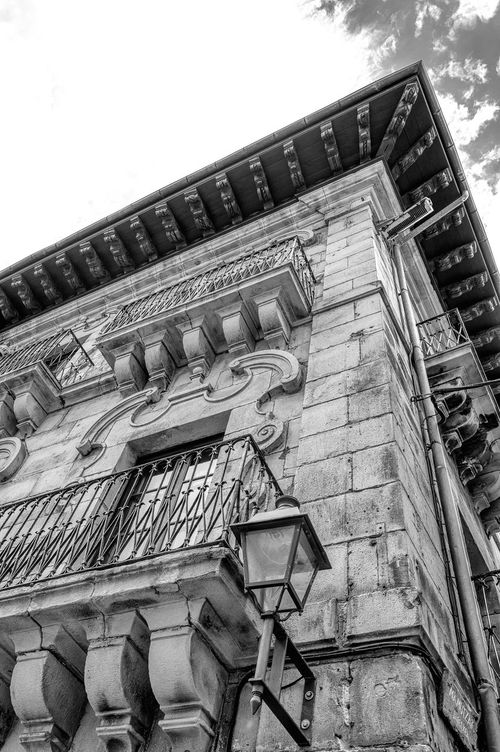 Looking up an old building Arch Arched Architectural Feature Architecture Architecture Building Exterior Built Structure City City Life Clear Sky Day Façade Historic Historic Building History Hondarribia Low Angle View No People Ornate Outdoors Sky Tall - High The Past Window