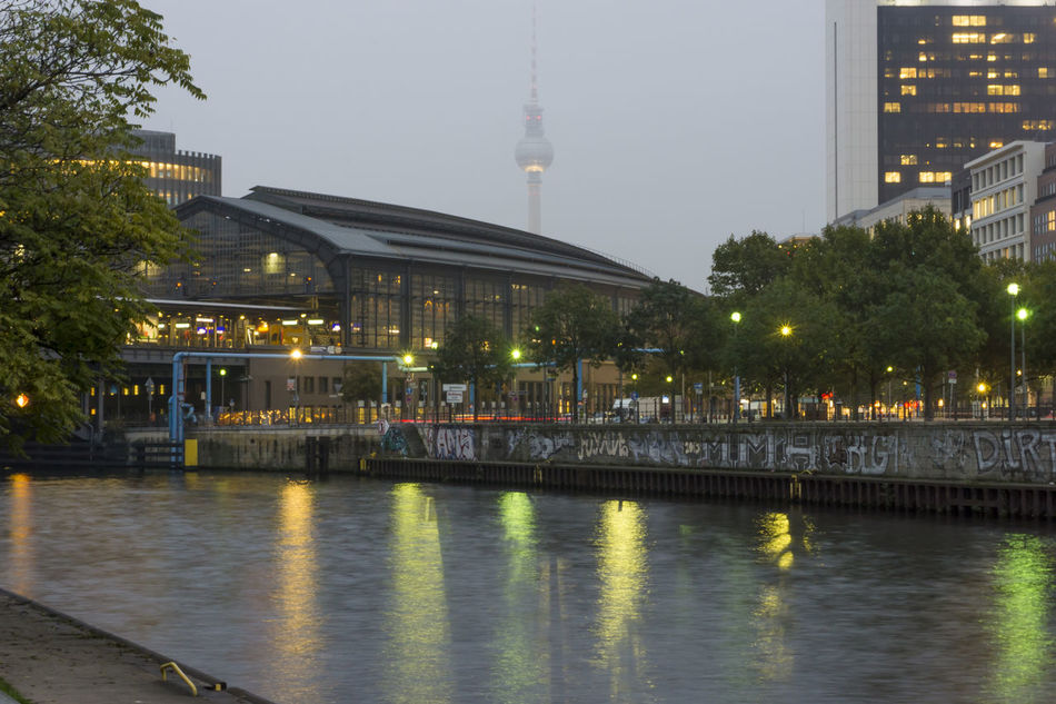 Friedrichstrasse Station at dusk with TV Tower in the background at a foggy day in Berlin, Germany Architecture Berlin Dusk Fog Friedrichstrasse Station Germany Hazy  Horizontal Illuminated Lit No People Photography Spree River Tv Tower Berlin Twilight