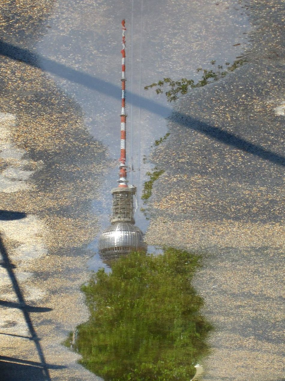 Tv Tower Berlin Reflection In Water After Rain Reflection In Puddle No People High Angle View Outdoors Water Berlin Mitte Wet And Dry Berlin Street Photography