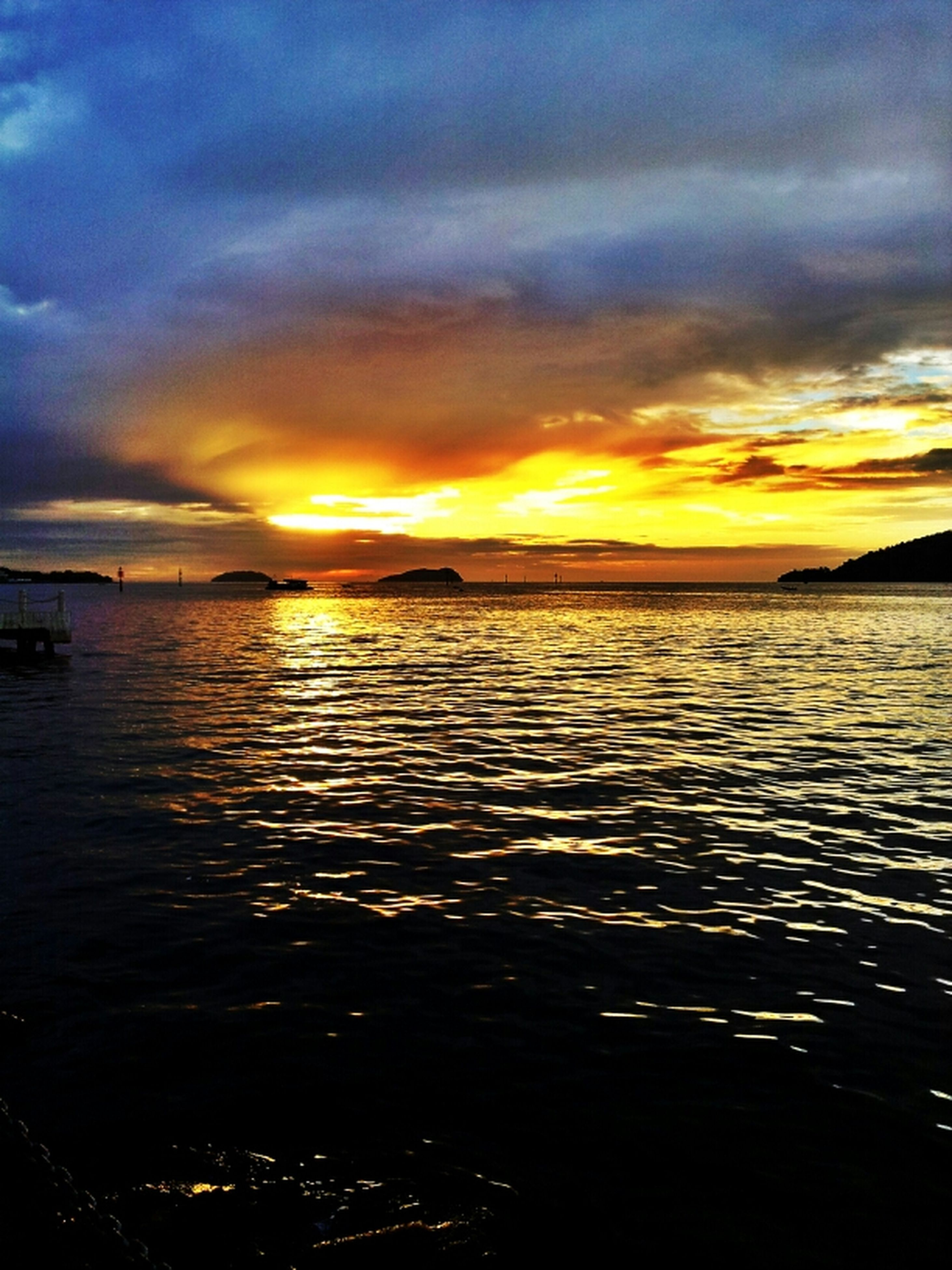 sunset, water, sky, scenics, sea, cloud - sky, tranquil scene, beauty in nature, orange color, tranquility, dramatic sky, idyllic, reflection, nature, cloud, cloudy, silhouette, waterfront, rippled, dusk
