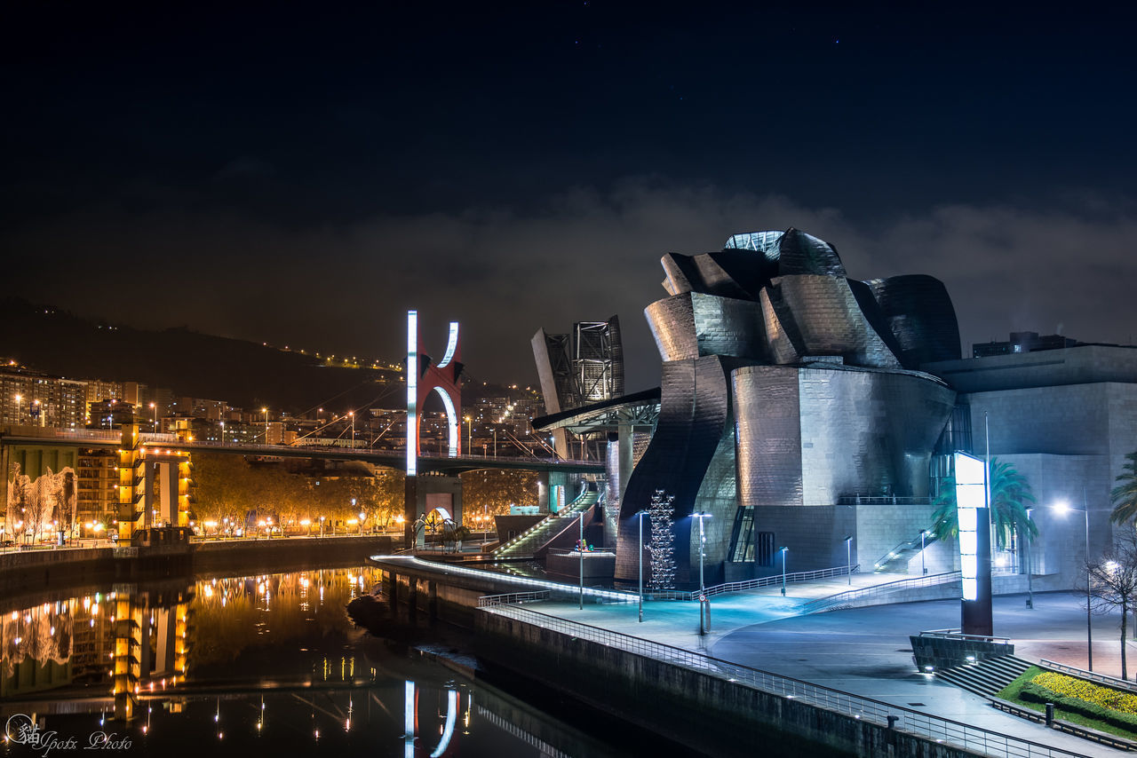Architecture Bilbaolovers Building Exterior Built Structure City Cityscape Factory Guggenheim Guggenheim Bilbao Illuminated Night No People Outdoors Sky Skyscraper Travel Destinations Urban Skyline Water