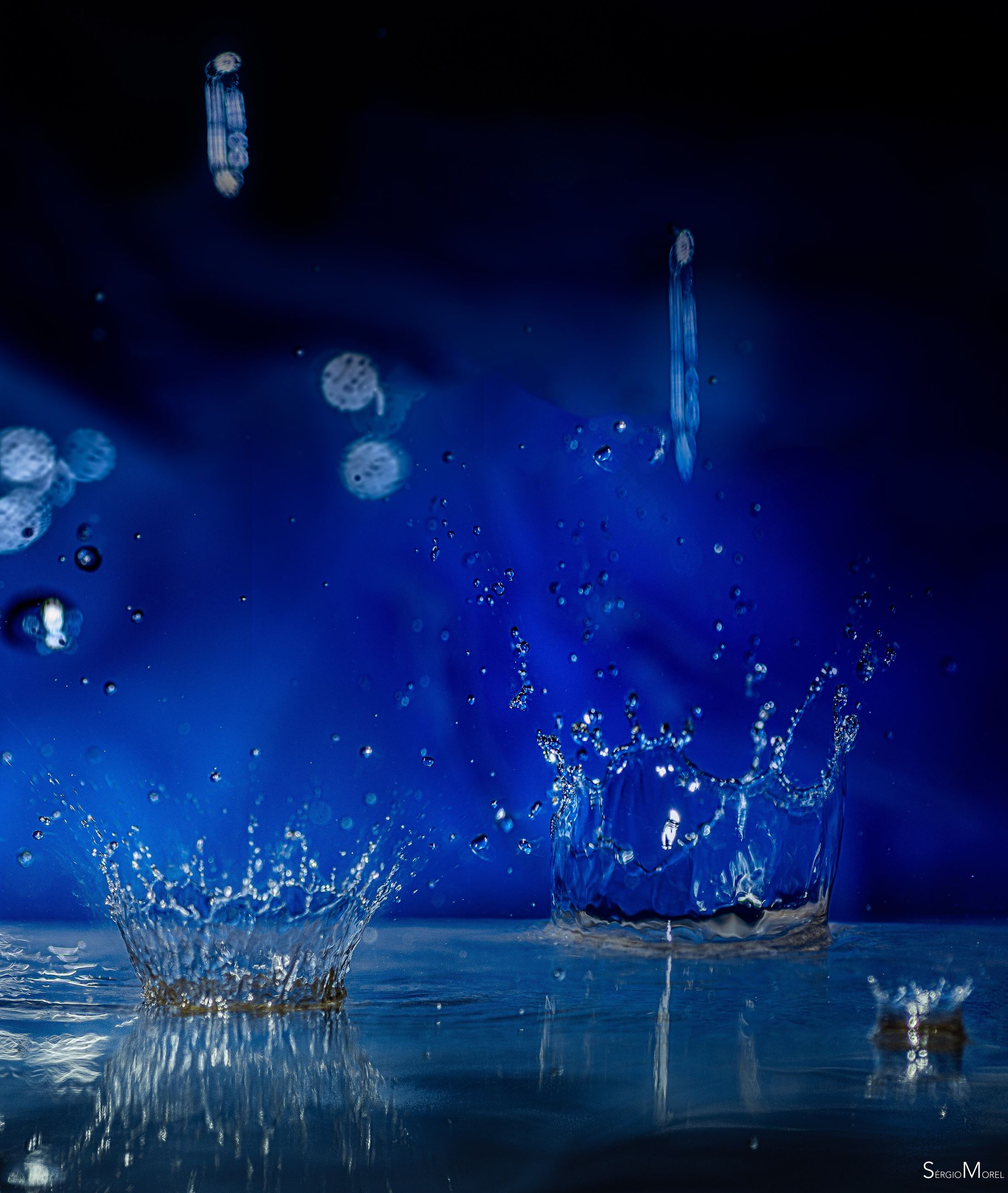water, splashing, motion, blue, waterfront, beauty in nature, high-speed photography, sea, outdoors, no people, nature, night, sky, close-up