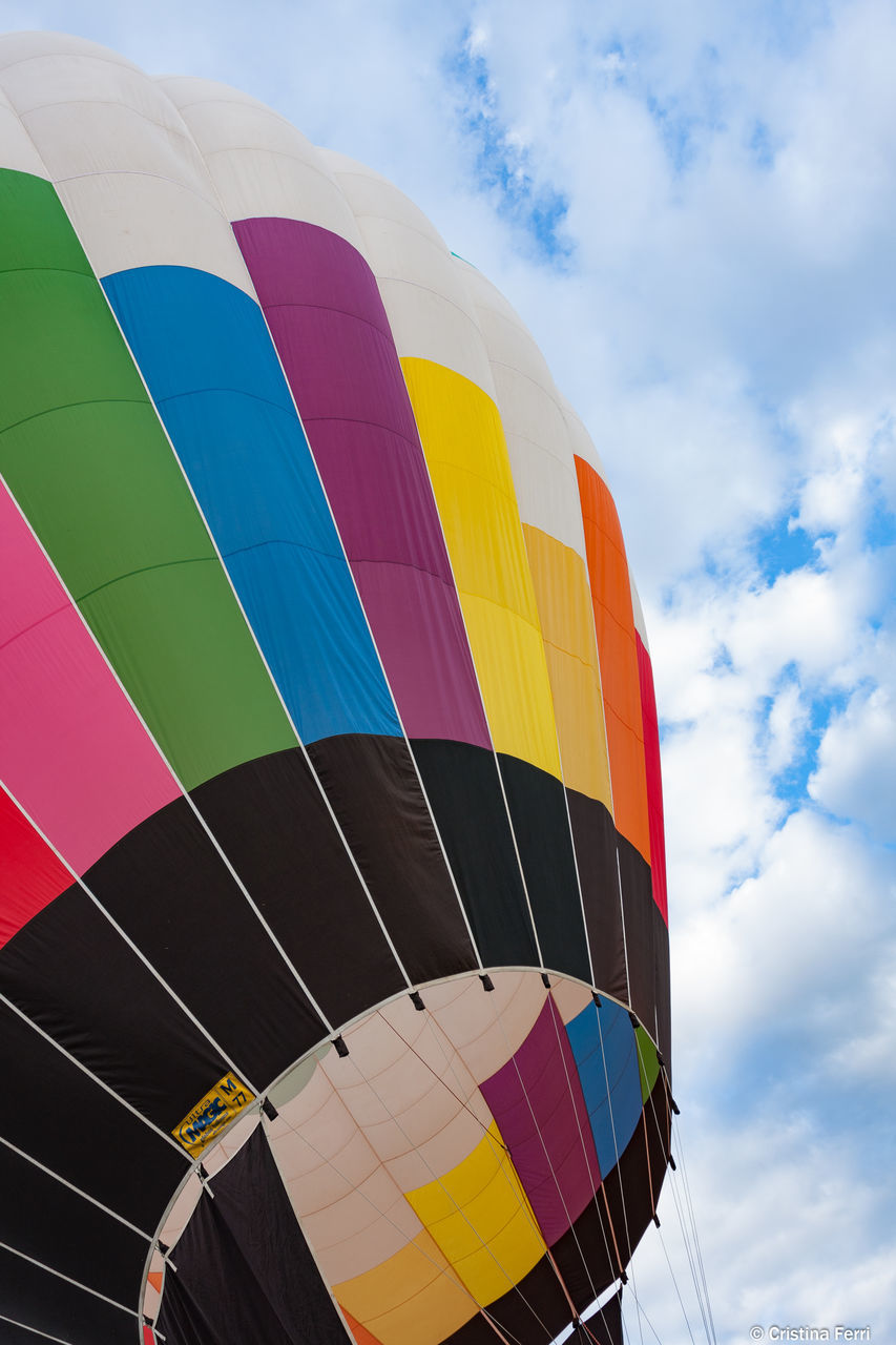 multi colored, hot air balloon, adventure, sky, cloud - sky, low angle view, transportation, outdoors, day, ballooning festival, air vehicle, extreme sports, no people, parachute