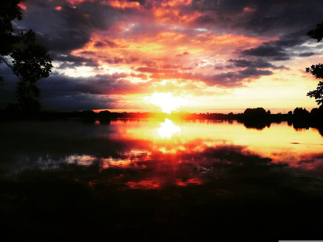Beauty In Nature Calm Cloud Cloud - Sky Cloudy Dramatic Sky Idyllic Majestic Moody Sky Nature No People Non-urban Scene Orange Color Outdoors Reflection Remote Scenics Sky Sun Sunbeam Sunlight Sunset Tranquil Scene Tranquility Water