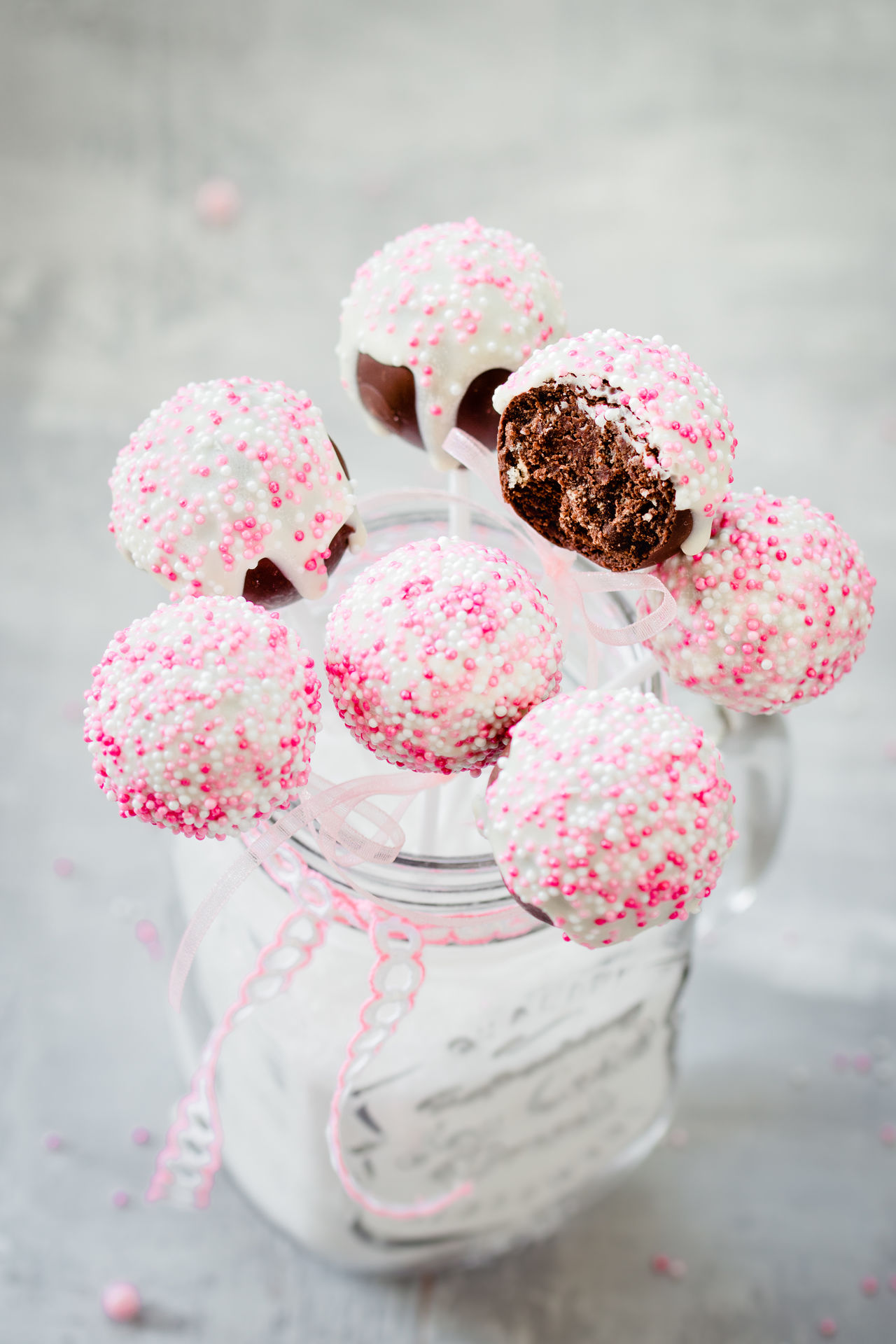 Baby Birthday Cake Cake Pops Chocolate Decorated Dessert Food And Drink Girl Lollipop No People Pink Color Served Sprinkles Sugar Sweet Sweet Food Table Weddi9ng White