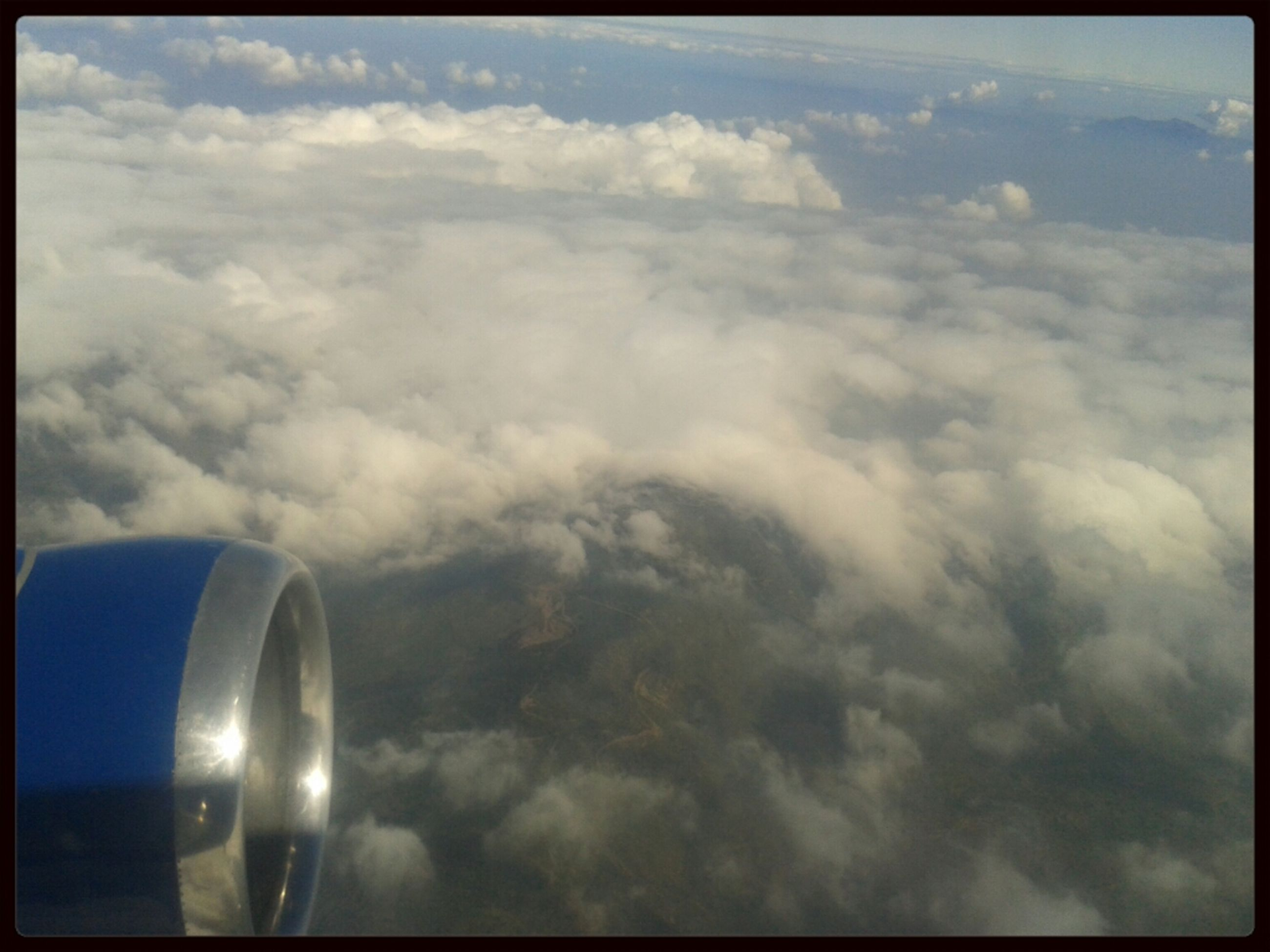 transfer print, sky, cloud - sky, auto post production filter, cloudy, cloud, scenics, beauty in nature, airplane, nature, cloudscape, tranquility, air vehicle, tranquil scene, weather, transportation, low angle view, no people, outdoors, idyllic