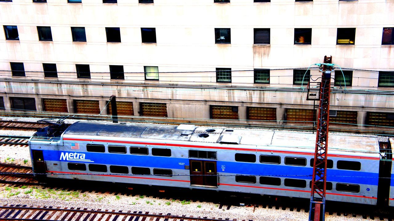 Metra Rail Architecture Building Exterior Built Structure Chicago Day Electrical Lines Metra Train Metro Mode Of Transport Outdoors Public Transportation Rail Track Rail Transportation Text Tracks Transportation Windows