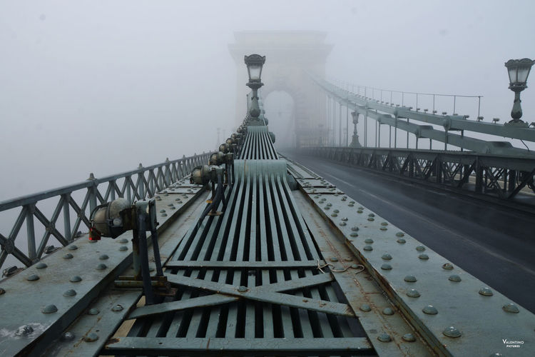 #budapest #ChainBridge #ICONICMARK #mistery #mistymorning #reportage Bridge - Man Made Structure City Day Fog No People Outdoors Railing Sky Staircase Steps