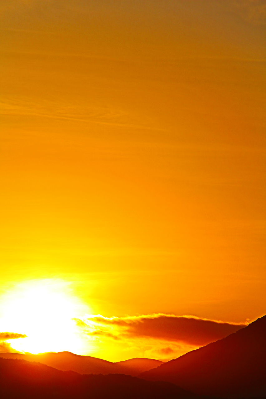 sunset, orange color, silhouette, scenics, beauty in nature, nature, sky, dramatic sky, tranquil scene, sun, outdoors, sunlight, tranquility, no people, yellow, mountain, landscape, day