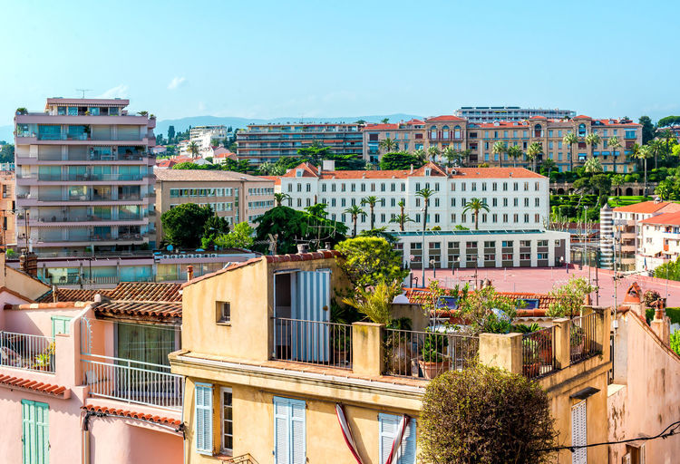 Houses of Cannes city. Provence Alpes Cote d'azur. France Architecture Blue Sky Building Exterior Cannes, France City Day Europe France French Riviera Highrise Hills Houses Landscape Outdoors Provence Alpes Cote D'azur Residential Building Roof Rooftop Sunny Tourist Resort Travel Destinations Typical Houses Urban View