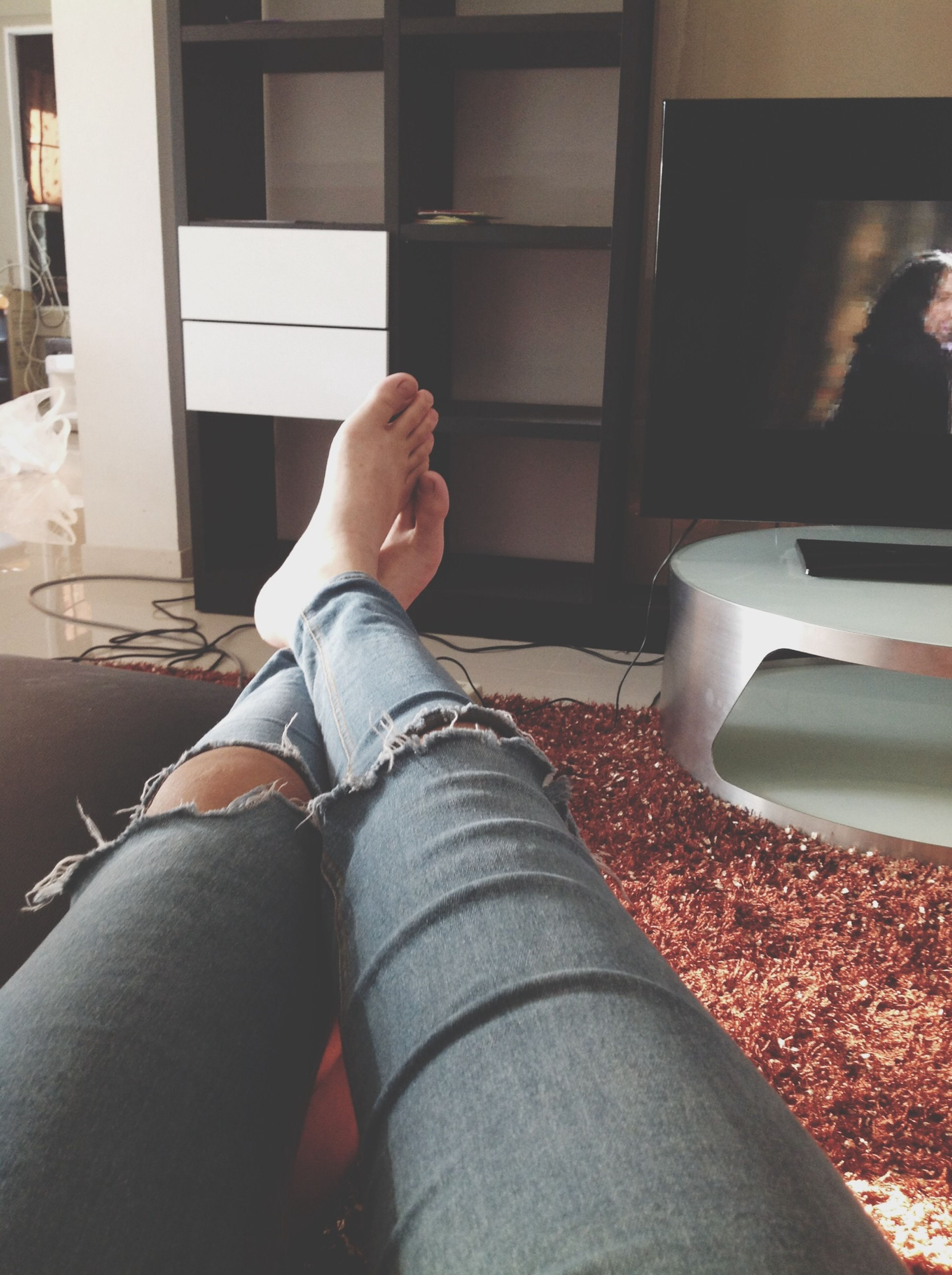low section, person, personal perspective, indoors, lifestyles, leisure activity, part of, relaxation, sitting, men, window, shoe, home interior, human foot, barefoot