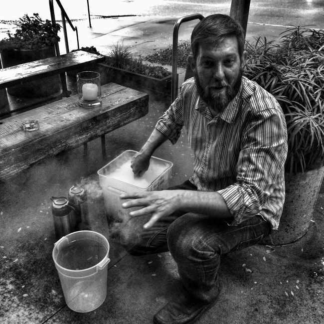 """Kevin preparing a batch of draft cocktail called the """"West Peachtree"""", chilling it down quickly with liquid nitrogen... Blackandwhite Weloveatl Cocktails"""