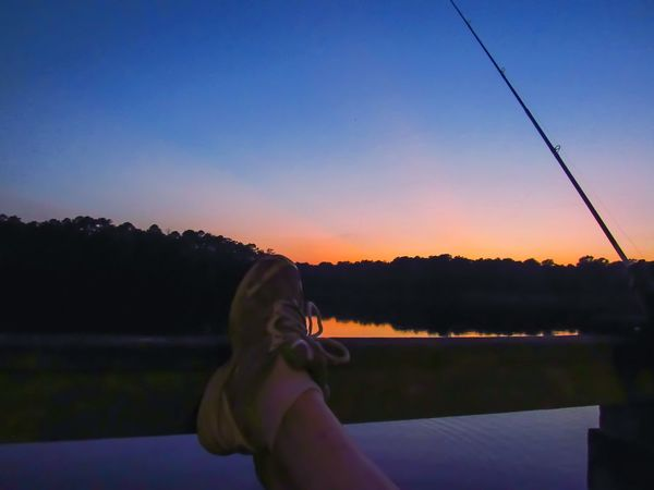 Relaxation Relaxing Feet Legs Legs Up Feet Up Tranquility Only Women Fishing Fishing Dock Catch And Release Dock Fishing Pier Water Activity Blue Hour Silhouette Sunset Water Night Sky Dusk Beauty In Nature Nature Adult People Lost In The Landscape