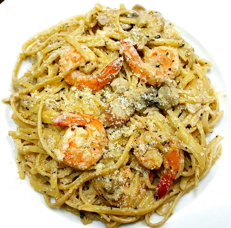 Creamy Spicy Seafood Pasta for dinner Food Pasta Plate Ready-to-eat Italian Food Seafood Shrimp Squid Clams Dinner Foodie Foodpornstar