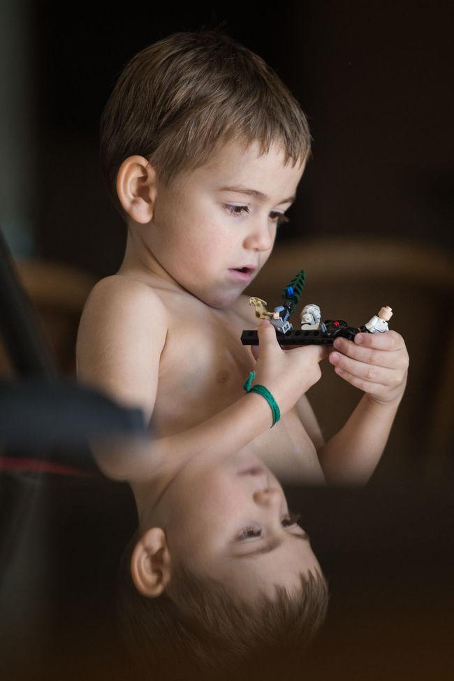 Little kid playing with Starwars Legos. Boys Childhood Cute Fun Headshot Innocence Kid Kids Lego Minifigures Lifestyles Person Playground Portrait Reflex Starwars Starwarstoys Toy First Eyeem Photo