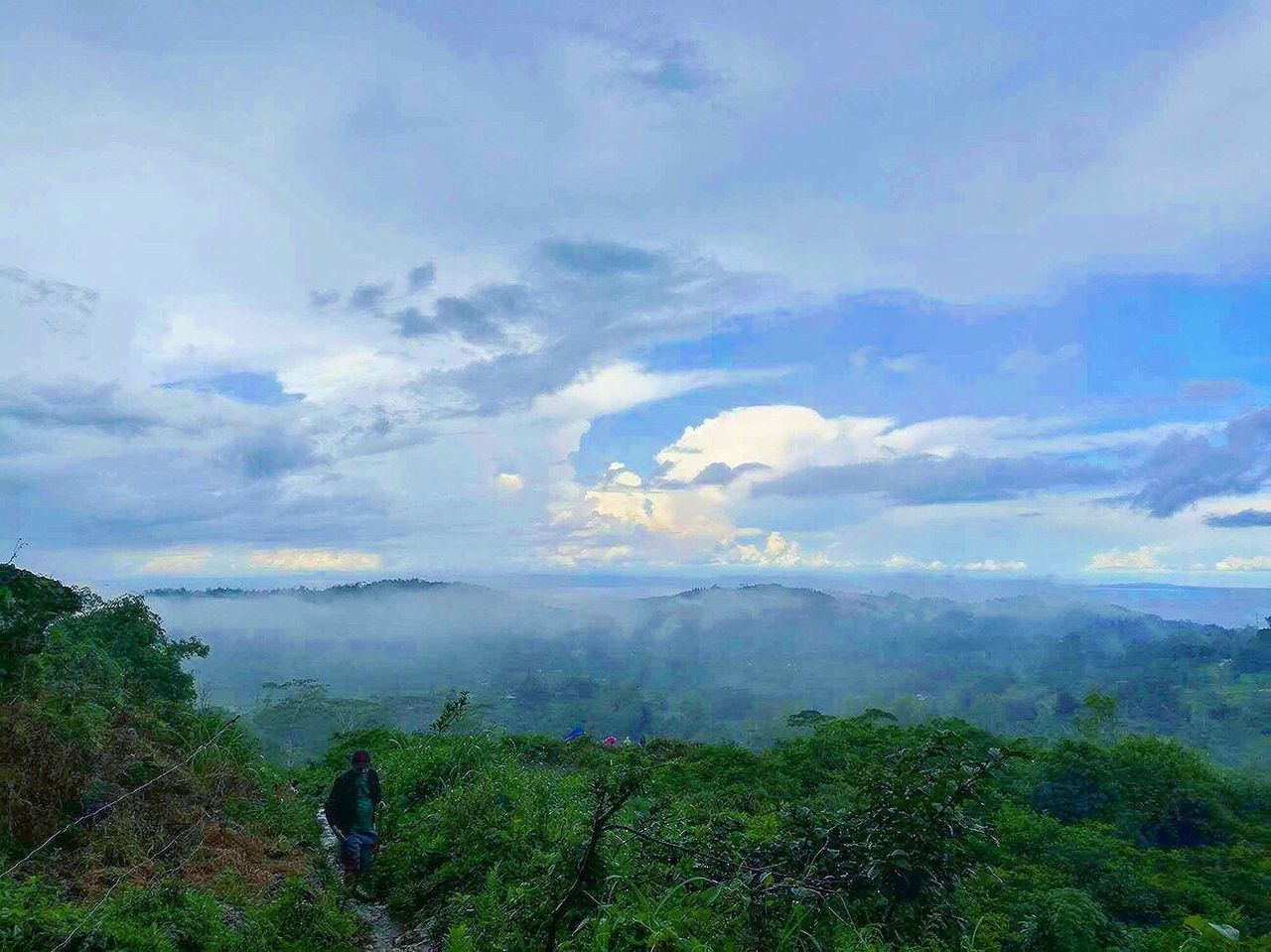 sky, nature, beauty in nature, real people, scenics, tranquil scene, cloud - sky, landscape, tranquility, day, outdoors, one person, growth, men, tree, mountain, people