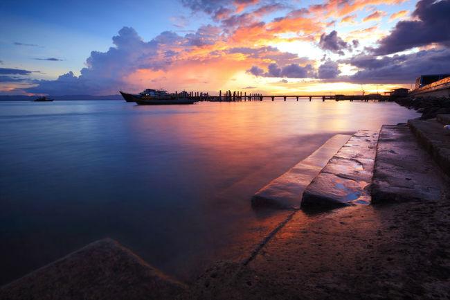 Awesome vivid sunset over the jetty Amazing Bay Beach Bench Boardwalk Bridge Cloud Cloudybridge Coast Colors Horizon Horizon Over Water Island Jetty Landscape Ocean Relax Relaxation Sabah Silhouette Sunset Taw Tawau Travel Water