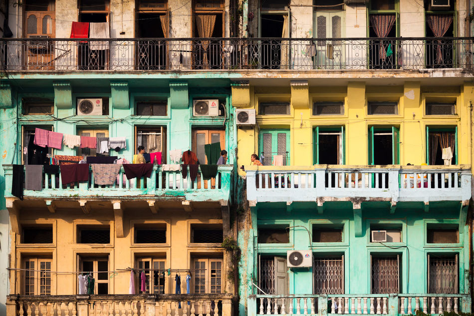 Chit-chatting at the balcony located at the old neighborhood of Yangon, Myanmar. Architecture Balcony British Building Exterior Built Structure Chitchat Gossip Myanmar Neighborhood Old Old Buildings Outdoors People Real People South East Asia Yangon