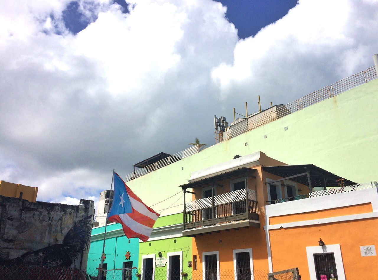 building exterior, built structure, architecture, sky, day, flag, cloud - sky, outdoors, low angle view, no people, city