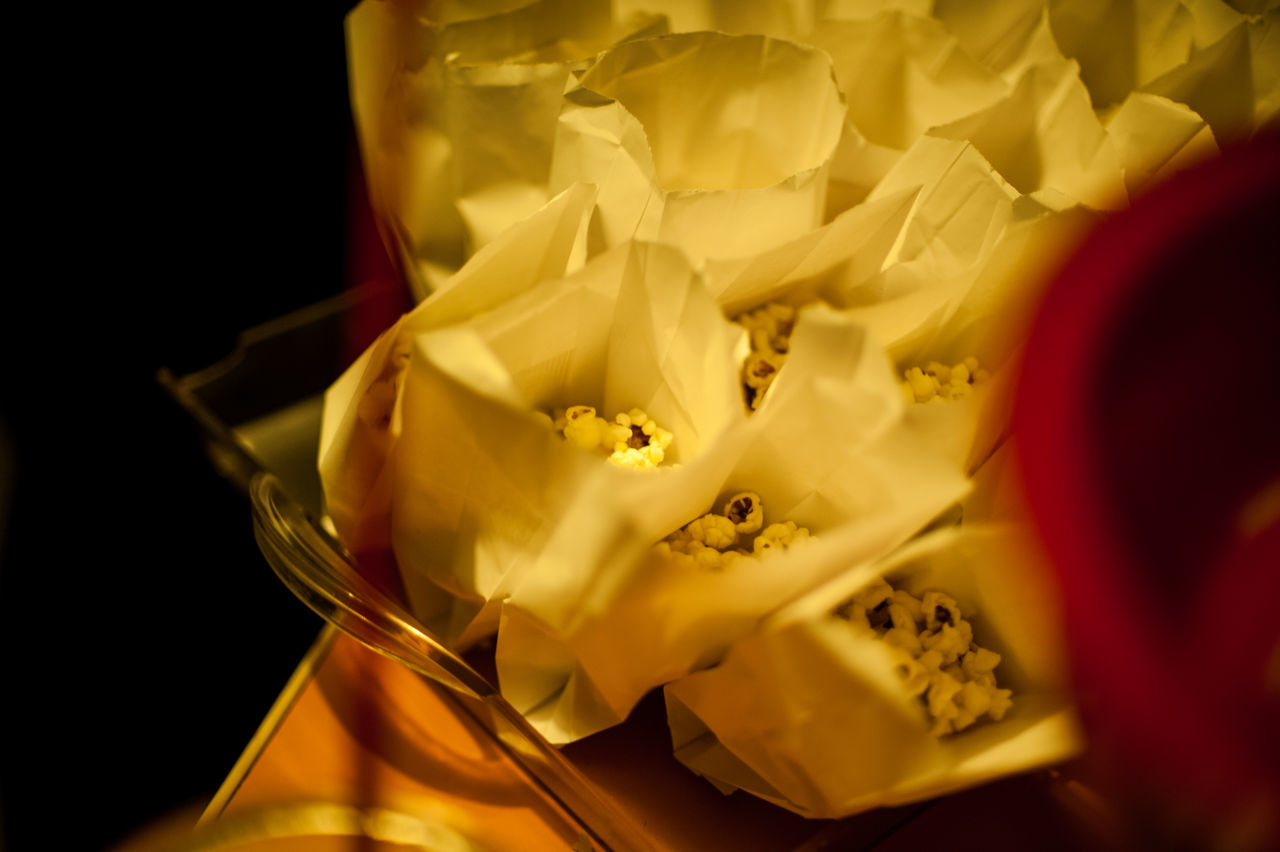 Popcorn in paper bags served in serving tray