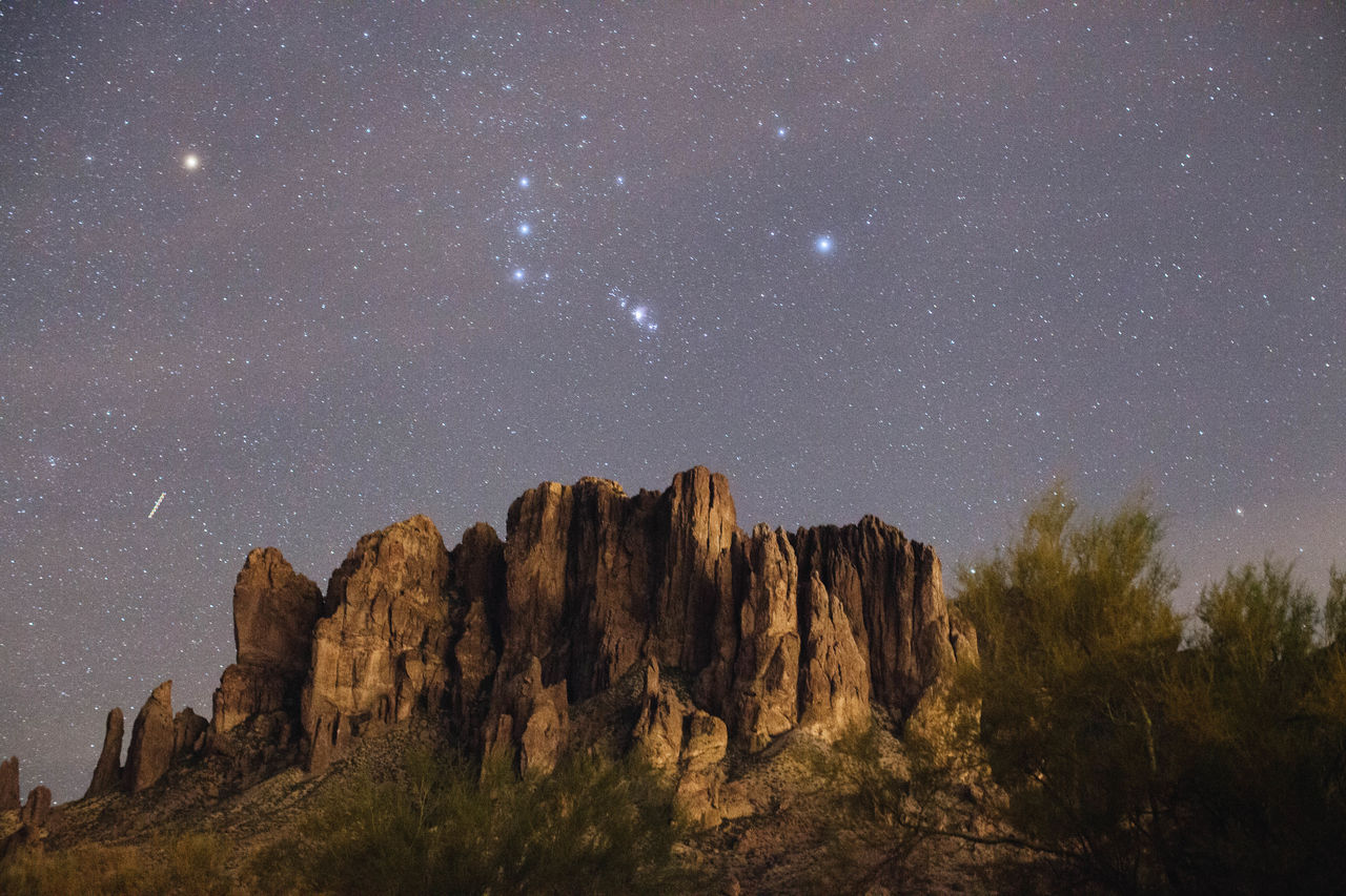 astronomy beauty in Nature Constellation Galaxy geology landscape Low angle view milky way Nature night no people outdoors physical geography rock - object Rock formation rock hoodoo scenics sky space star - space tranquil scene Tranquility