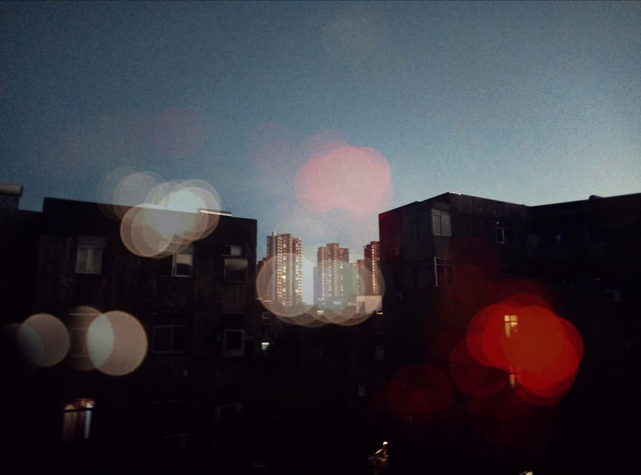 balloon, celebration, building exterior, architecture, illuminated, no people, city, outdoors, sky, day