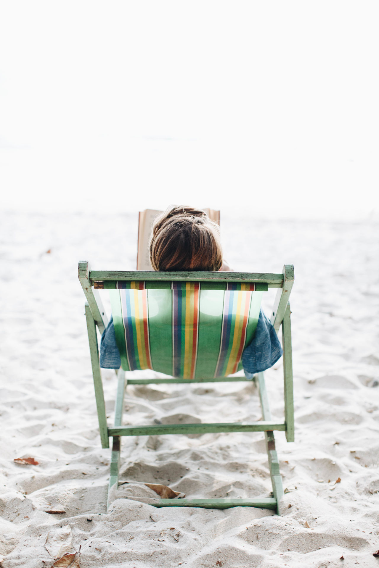 beach beach chair Bright Chair childhood day female horizon over water Nature one person outdoors people Reading Rear view relax relaxation sand sea sky water white Woman woman reading