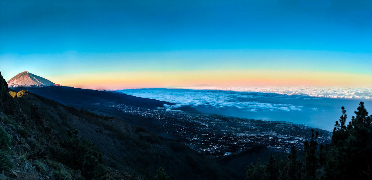 amazing view of sunrise from Teide National Park above clouds and city Above Amazing View Beauty In Nature Blue City Cityscape Cloud - Sky Clouds Clouds And Sky Day Landscape Mountain Mountain Peak Mountain Range Nature No People Outdoors Scenics Sky Snow Sunrise Sunset Sunset_collection Tranquility Travel Destinations