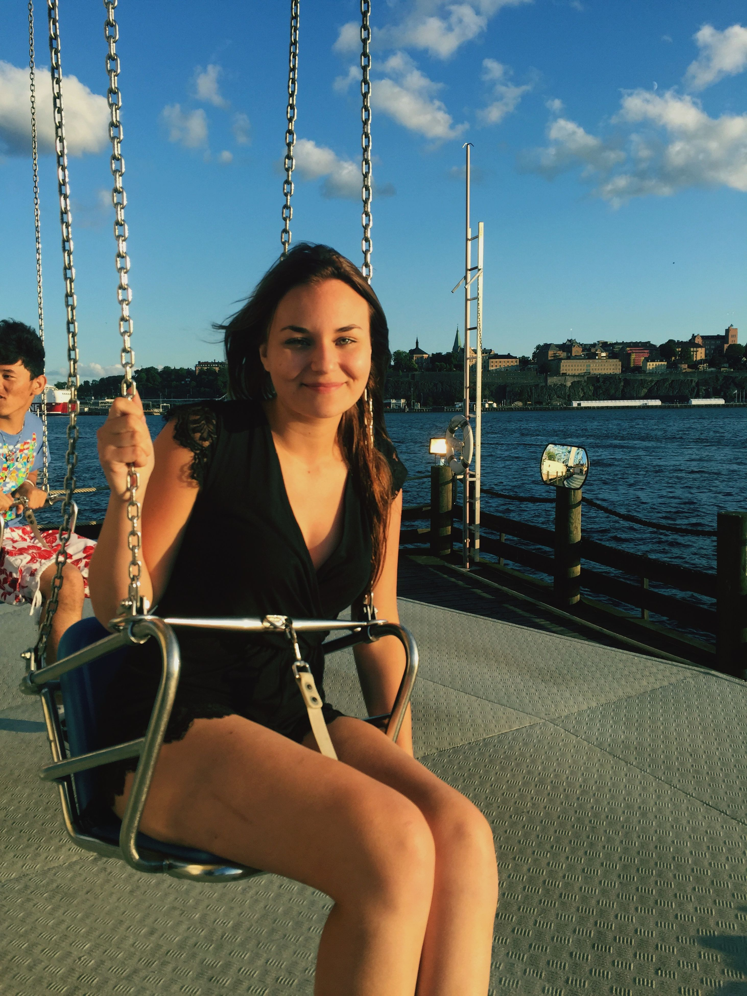 young adult, lifestyles, young women, leisure activity, person, water, casual clothing, looking at camera, portrait, front view, sunglasses, sitting, transportation, standing, nautical vessel, built structure, sky