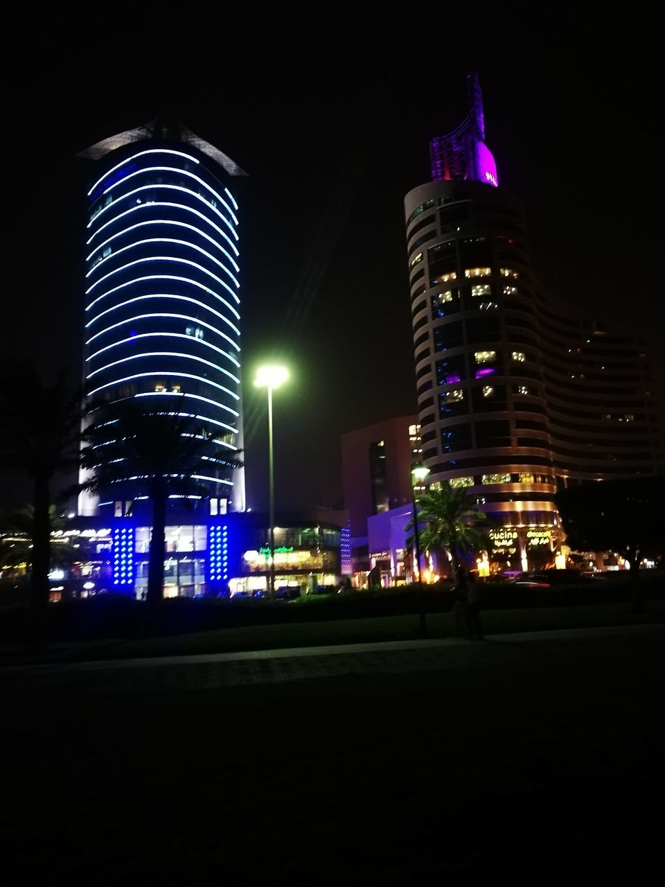 night, illuminated, building exterior, architecture, tall - high, built structure, skyscraper, city, modern, no people, low angle view, sky, outdoors, travel destinations, cityscape, urban skyline