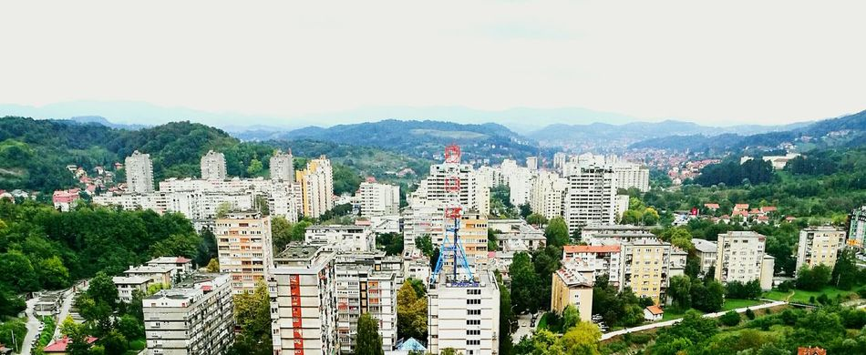 Cityscape High Angle View Tuzla,Bosnia And Herzegovina Goranvonkarkin Enjoying Life Architecture Architecture Building Exterior Built Structure City Cityscape High Angle View Crowded Mountain Tall - High Tower Cloud - Sky Sky Mountain Range Development Skyscraper Residential District Office Building Day Outdoors