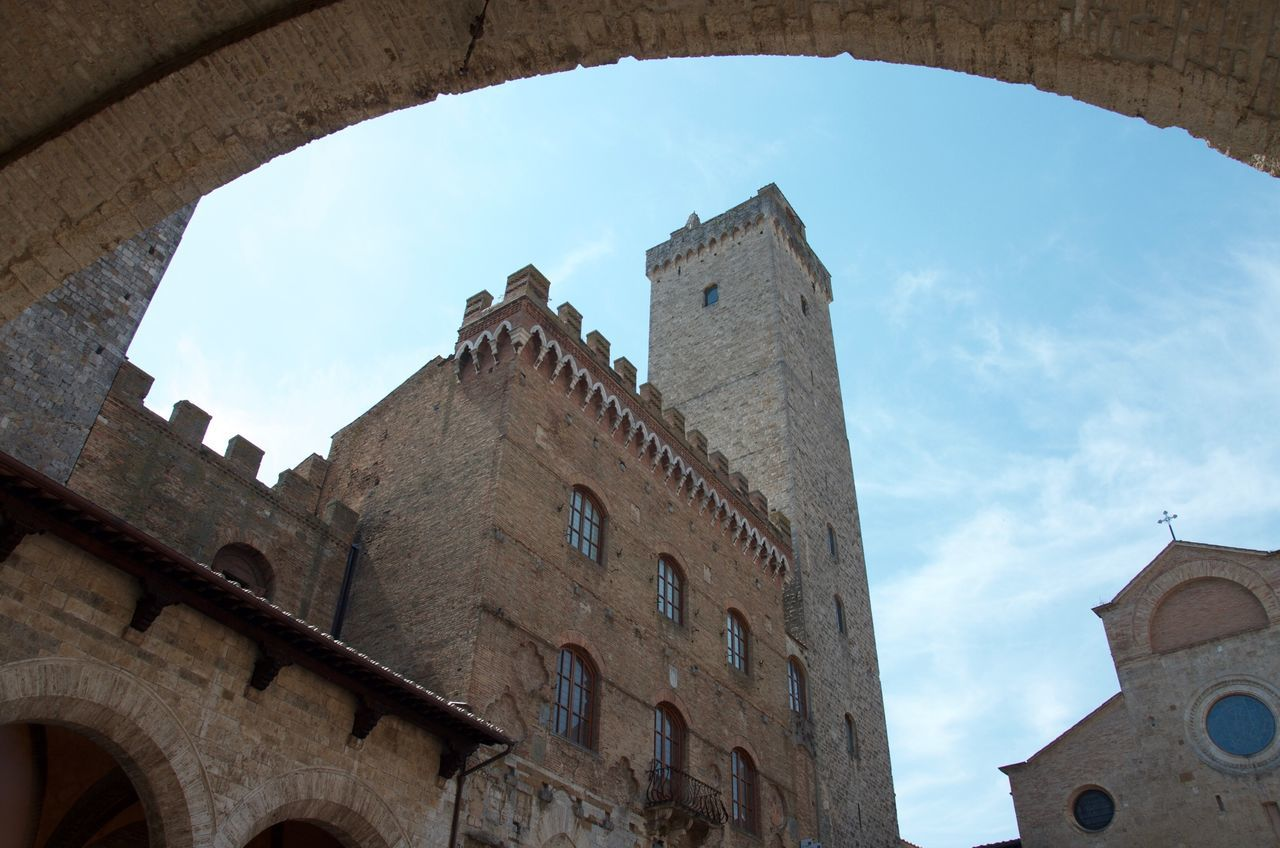 Low angle view of old buildings against sky at Volterra