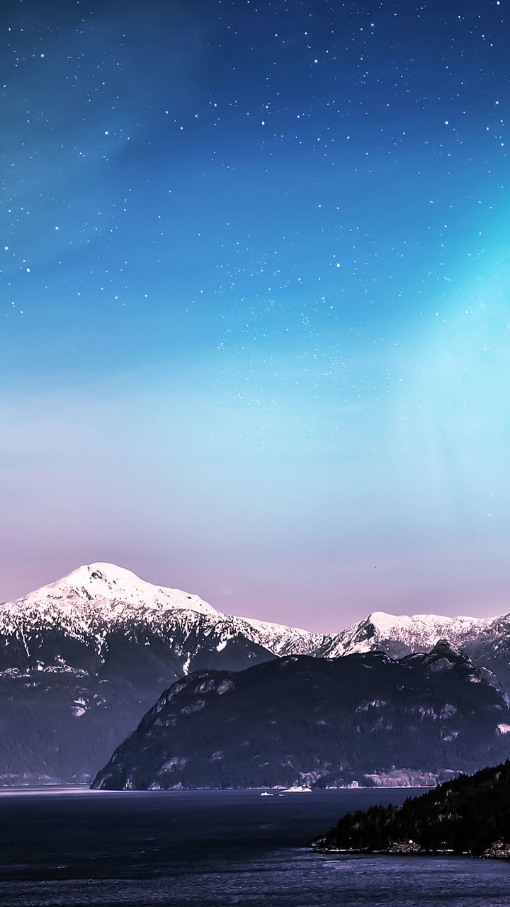 mountain, snow, cold temperature, winter, nature, scenics, beauty in nature, mountain range, snowcapped mountain, tranquil scene, sky, ice, night, tranquility, frozen, no people, star - space, water, blue, lake, landscape, outdoors, astronomy, constellation, galaxy, clear sky, iceberg, astrology sign