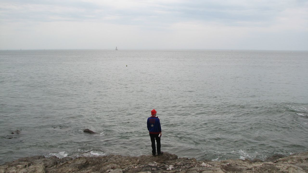 A man and the sea Calm Ocean Red Hat Sea Shore The Purist (no Edit, No Filter) Water