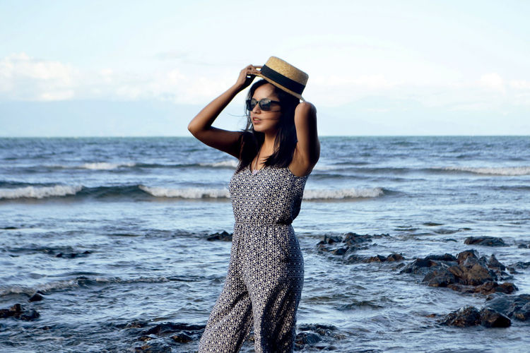 Beach Beauty In Nature Casual Clothing Front View Horizon Over Water Idyllic Leisure Activity Lifestyles Long Hair Nature Person Scenics Sea Shore Sky Smiling Standing Three Quarter Length Tranquil Scene Tranquility Vacations Water Wave Young Adult Young Women