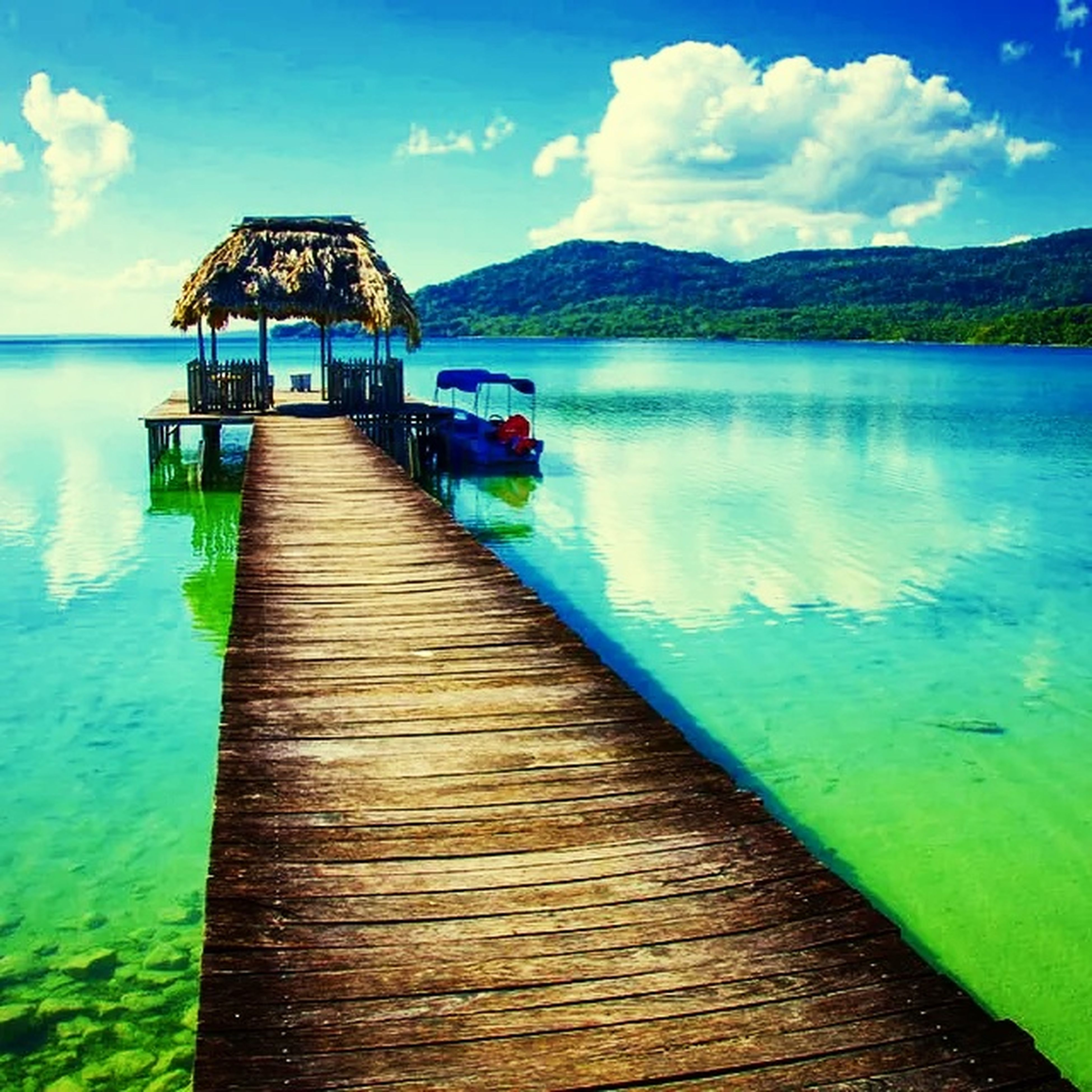 water, sky, wood - material, tranquility, pier, tranquil scene, blue, lake, sea, scenics, cloud - sky, mountain, nature, built structure, cloud, beauty in nature, jetty, wood, boardwalk, idyllic