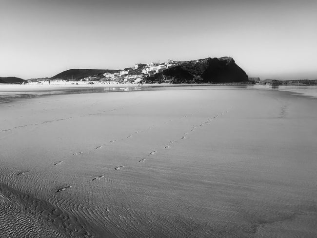 Strand bei Aljezur Black and white Algarve Aljezur Atlantic Beach Beauty In Nature Blackandwhite Coastline Distant Natural Landmark Portugal Remote Sand Scenics Sea Seascape Tourism Tranquil Scene Tranquility Travel Destinations Vacations Water Monochrome Photography