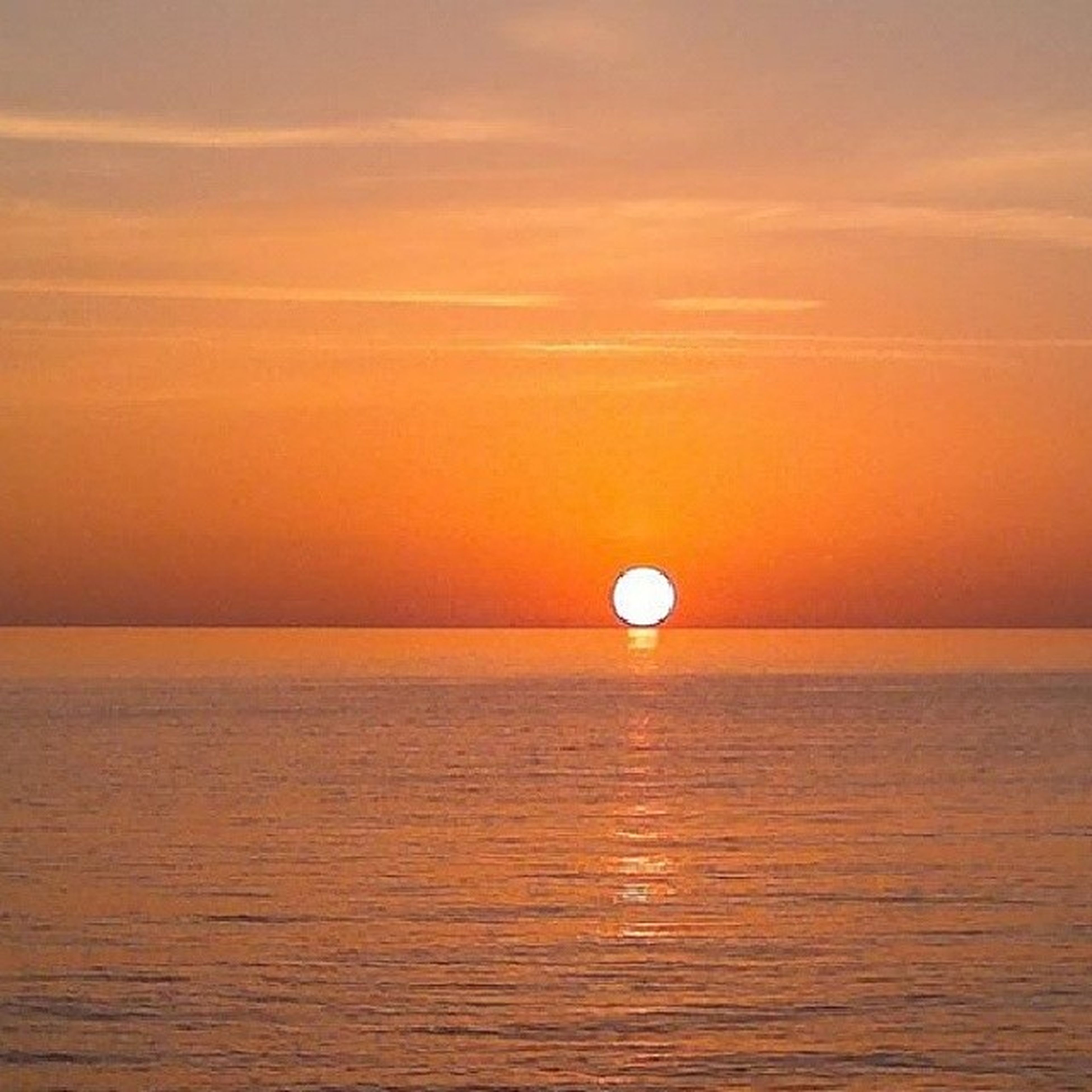 sunset, scenics, tranquil scene, sun, tranquility, orange color, beauty in nature, water, sea, horizon over water, sky, idyllic, waterfront, nature, reflection, rippled, no people, seascape, outdoors, remote
