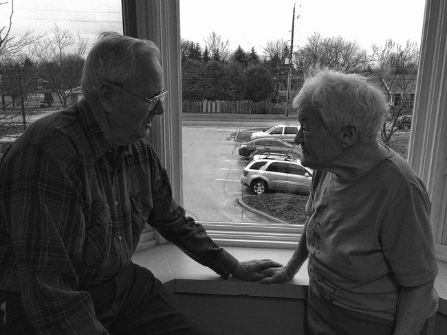 I took this photo with my iPhone of my mother-in-law who has Alzheimers looking at my father-in-law, they have been married for almost 60 years and she sadly no longer remembers him... Alzeimer's Disease AlzheimersAwareness Elderlypeople Grandfather Grandmother Grandparents Love Marriage  Black And White People Family People Photography