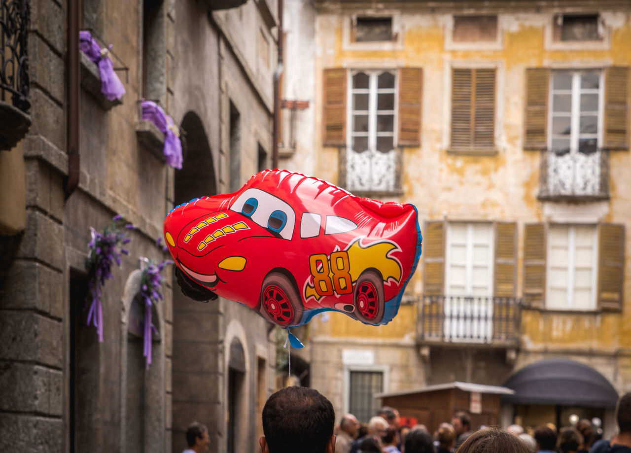 Architecture Balloon Balloons Building Exterior Built Structure Celebration Chiavenna City City Cultures Day Focus On Foreground Italy No People Old City People Red The Drive Traditional Festival Chance Encounters