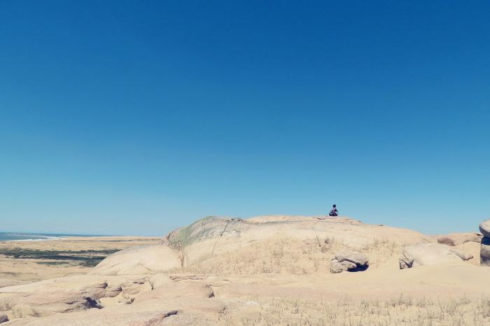 Blue Clear Sky Sand Travel Real People Desert Full Length Sky One Person Outdoors Day Sand Dune Landscape People Only Men Arid Climate Nature Cabo Polonio Uruguay Naturaleza Desert Miles Away