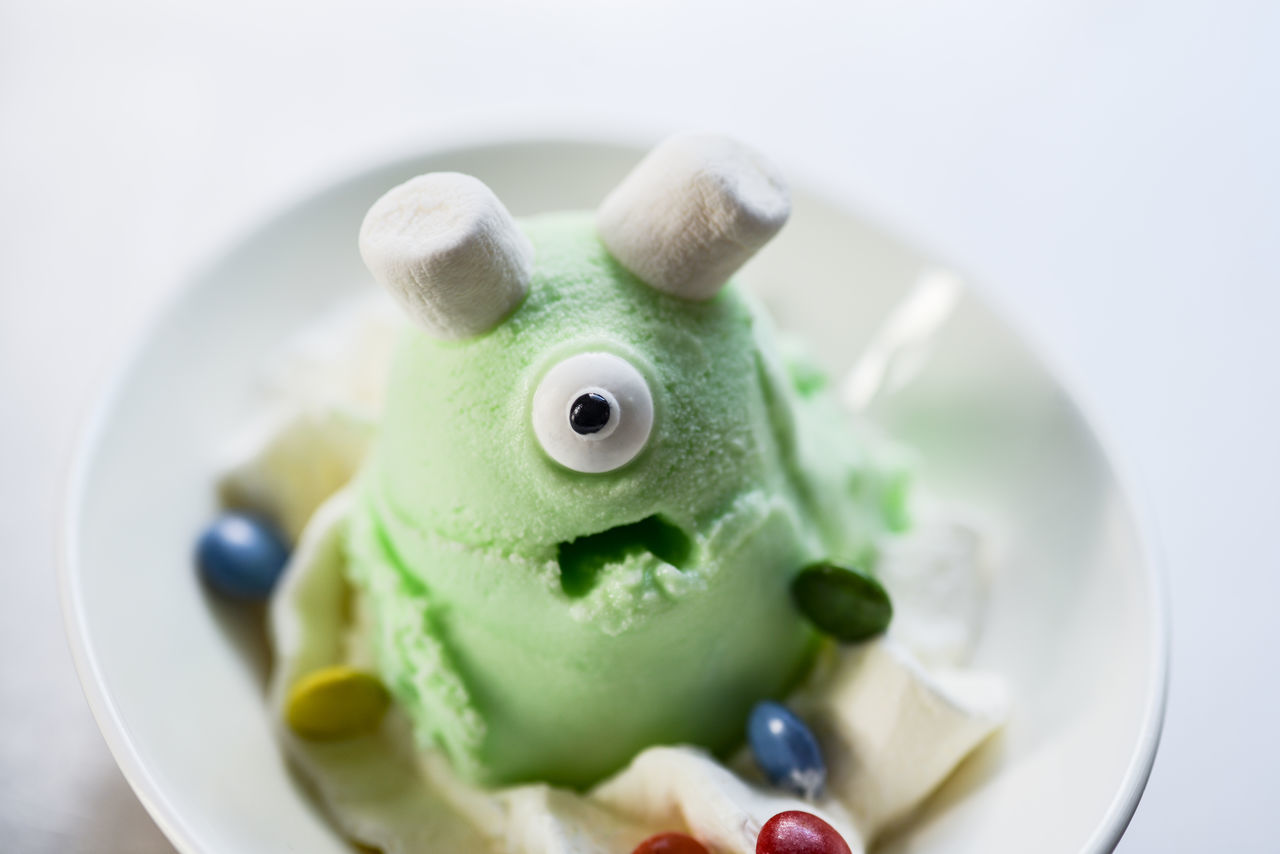 Close-up Day Desert Deserts Around The World Dessert Eye Food Food And Drink Freshness Gelato Green Color Ice Monsters Indoors  Indulgence No People Plate Ready-to-eat Selective Focus Studio Shot Sweet Food Temptation Toy Unhealthy Eating Visual Feast White Background