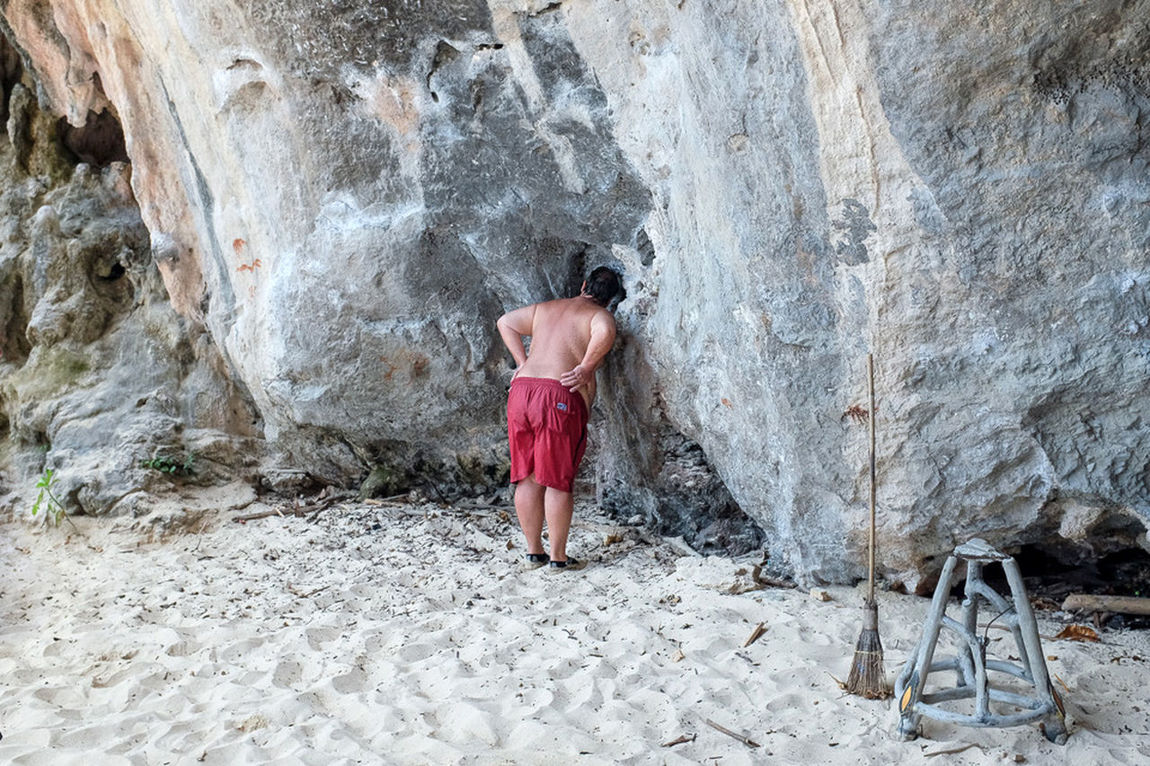 Phra Nang Beach, Krabi province, Thailand Adult Beauty Broomstick Curiosity Day Full Length Horizontal Inspection Krabi Lifestyles One Person One Woman Only Outdoors People Person Pink Color Real People Rear View Rock Street Photography Streetphotography Tourism Tourist Water Working