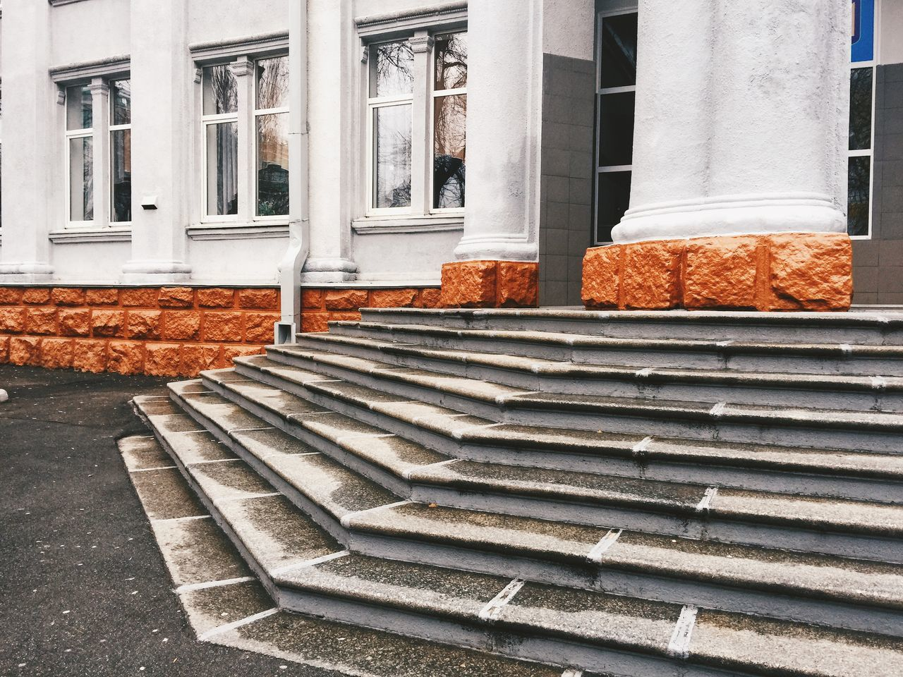 Steps of the USSR kind of building in Kiev, Ukraine Architectural Column Architecture Architecture Beautiful Brick Building Exterior Built Structure Column Day Empty Facades Frame Kiev No People Outdoors Stair Steps Street Tourism Travel Ukraine Ussr Wet Window Winter