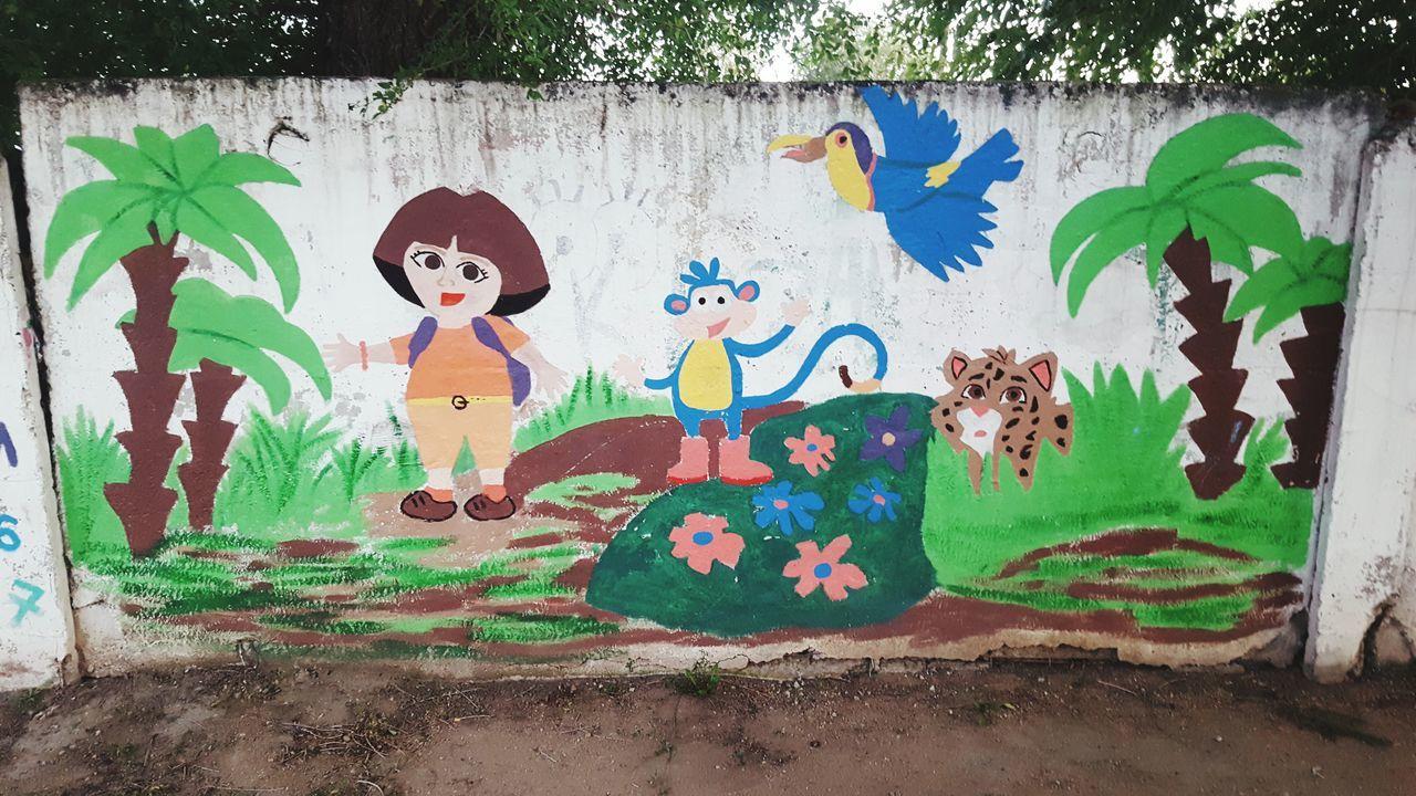 art and craft, creativity, human representation, male likeness, graffiti, female likeness, street art, outdoors, day, plant, doll, childhood, leaf, tree, no people, painted image, close-up