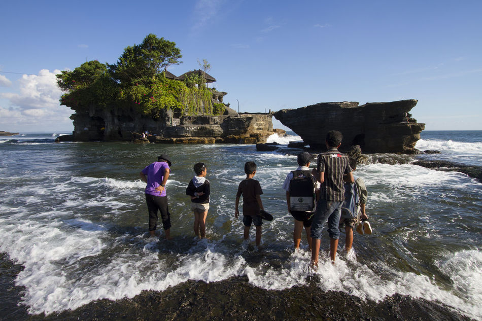 Tanah Lot Temple, Bali, Indonesia. Bali Beach INDONESIA Island Local People Sea Standing Tanah Lot Temple Tourist Travel Destinations Ubud Water Wave